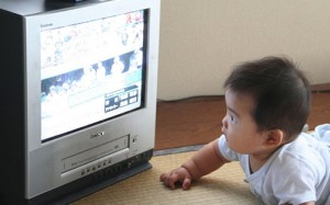 Infant in front of TV